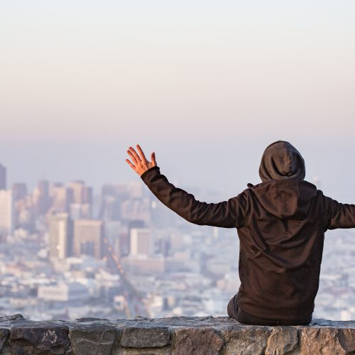 man-with-open-arms-saluting-the-san-francisco-city-picjumbo-com